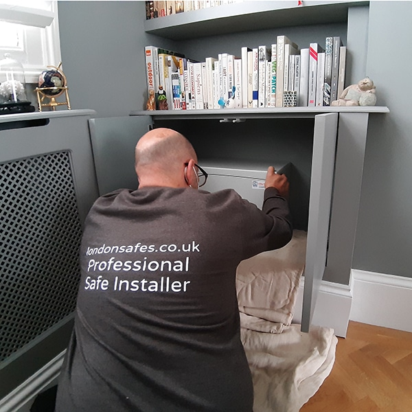 One of our professional and vetted engineers installing a home safe